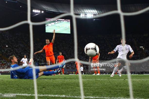 Mario Gomez of Germany scores their first goal past Maarten Stekelenburg of Netherlands during the UEFA EURO 2012 group B match between Netherlands...