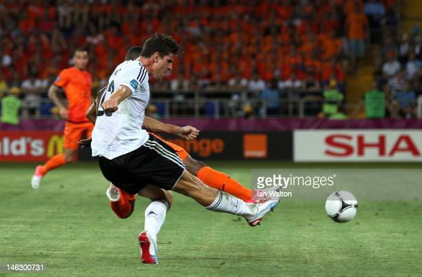 Mario Gomez of Germany scores their second goal during the UEFA EURO 2012 group B match between Netherlands and Germany at Metalist Stadium on June...