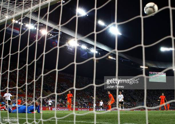 Mario Gomez of Germany scores their second goal past Maarten Stekelenburg of Netherlands during the UEFA EURO 2012 group B match between Netherlands...