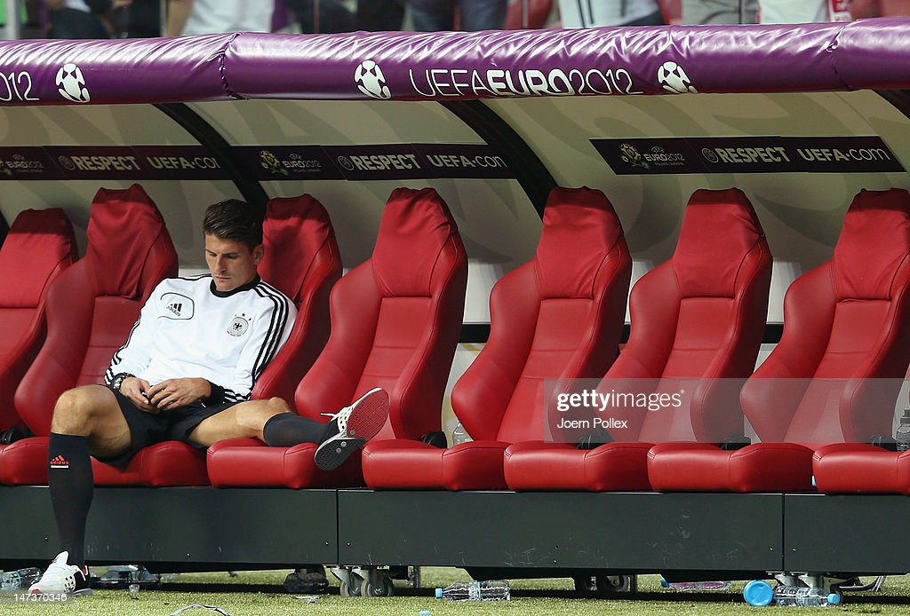 Mario Gomez of Germany shows his dejection as he sits on the bench after the UEFA EURO 2012 semi final match between Germany and Italy at National Stadium on June 28, 2012 in Warsaw, Poland.