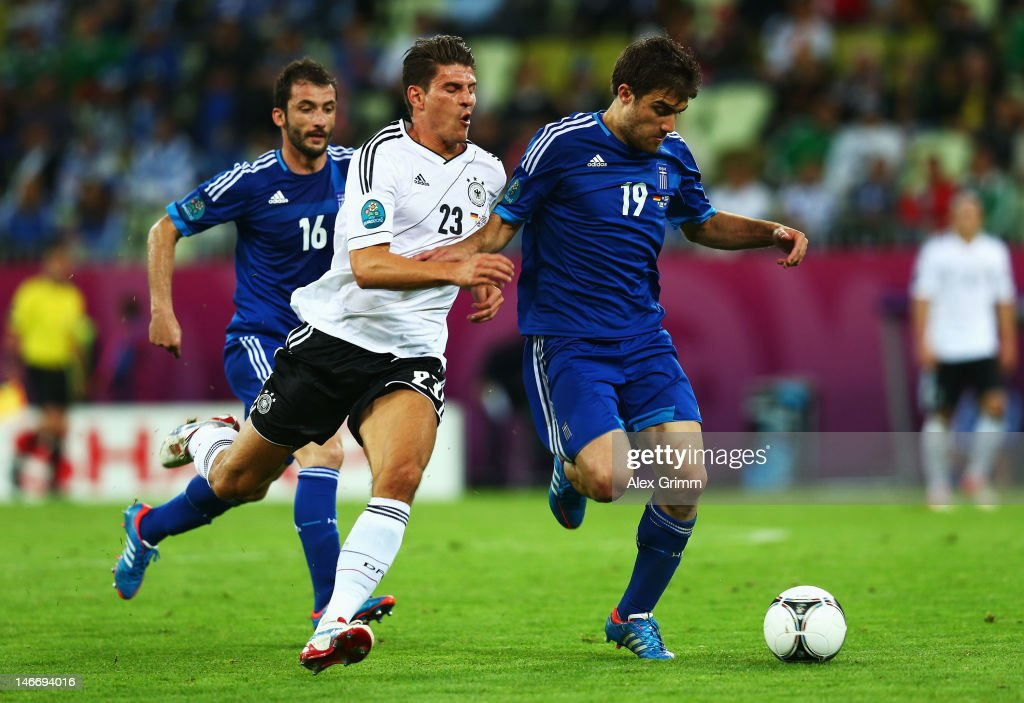 Mario Gomez of Germany tackles <a gi-track='captionPersonalityLinkClicked' href=/galleries/search?phrase=Sokratis+Papastathopoulos+-+Soccer+Player&family=editorial&specificpeople=4426771 ng-click='$event.stopPropagation()'>Sokratis Papastathopoulos</a> of Greece during the UEFA EURO 2012 quarter final match between Germany and Greece at The Municipal Stadium on June 22, 2012 in Gdansk, Poland.