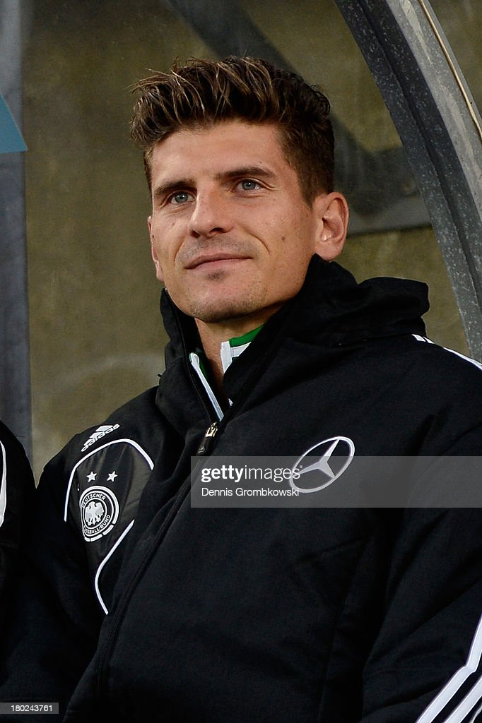 Mario Gomez of Germany takes seat on the bench prior to the FIFA 2014 World Cup Qualifier match between Faeroe Islands and Germany on September 10, 2013 in Torshavn, Denmark.