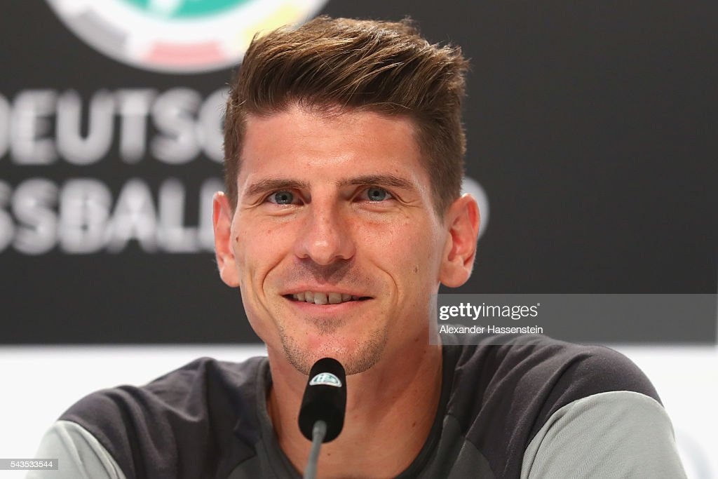 <a gi-track='captionPersonalityLinkClicked' href=/galleries/search?phrase=Mario+Gomez+-+Soccer+Player&family=editorial&specificpeople=635161 ng-click='$event.stopPropagation()'>Mario Gomez</a> of Germany talks to the media during a Germany press conference at Ermitage Evian on June 29, 2016 in Evian-les-Bains, France.