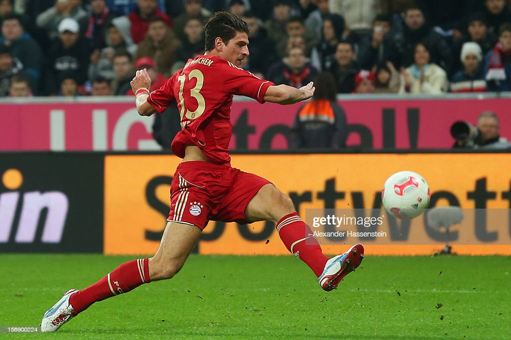 Mario Gomez of Muenchen battles for the ball during the Bundesliga match between FC Bayern Muenchen and Hannover 96 at Allianz Arena on November 24, 2012 in Munich, Germany.