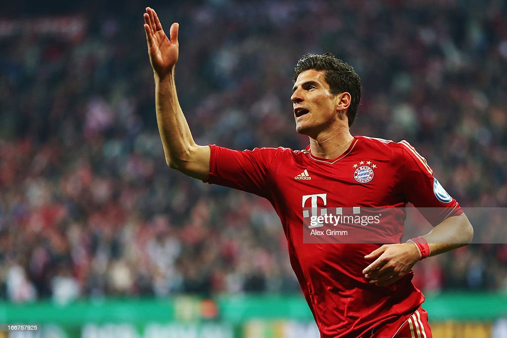 Mario Gomez of Muenchen celebrates his team's fifth goal during the DFB Cup Semi Final match between Bayern Muenchen and VfL Wolfsburg at Allianz Arena on April 16, 2013 in Munich, Germany.