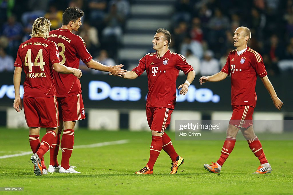<a gi-track='captionPersonalityLinkClicked' href=/galleries/search?phrase=Mario+Gomez+-+Soccer+Player&family=editorial&specificpeople=635161 ng-click='$event.stopPropagation()'>Mario Gomez</a> (2L) of Muenchen celebrates his team's fifth goal with team mates Anatoliy Tymoshchuk, <a gi-track='captionPersonalityLinkClicked' href=/galleries/search?phrase=Xherdan+Shaqiri&family=editorial&specificpeople=6923918 ng-click='$event.stopPropagation()'>Xherdan Shaqiri</a> and <a gi-track='captionPersonalityLinkClicked' href=/galleries/search?phrase=Arjen+Robben&family=editorial&specificpeople=194740 ng-click='$event.stopPropagation()'>Arjen Robben</a> (L-R) during the friendly match between Bayern Muenchen and FC Schalke 04 at Jassim Bin Hamad Stadium on January 8, 2013 in Doha, Qatar.