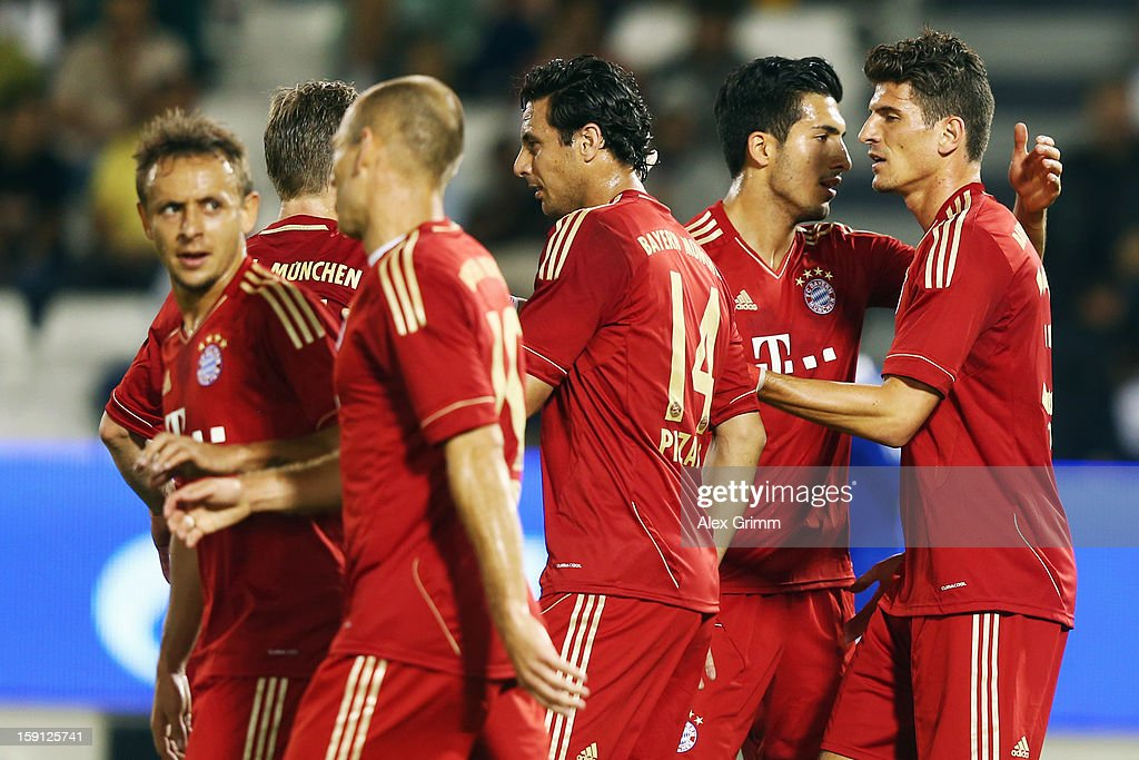 <a gi-track='captionPersonalityLinkClicked' href=/galleries/search?phrase=Mario+Gomez+-+Soccer+Player&family=editorial&specificpeople=635161 ng-click='$event.stopPropagation()'>Mario Gomez</a> (R) of Muenchen celebrates his team's fifth goal with team mates during the friendly match between Bayern Muenchen and FC Schalke 04 at Jassim Bin Hamad Stadium on January 8, 2013 in Doha, Qatar.