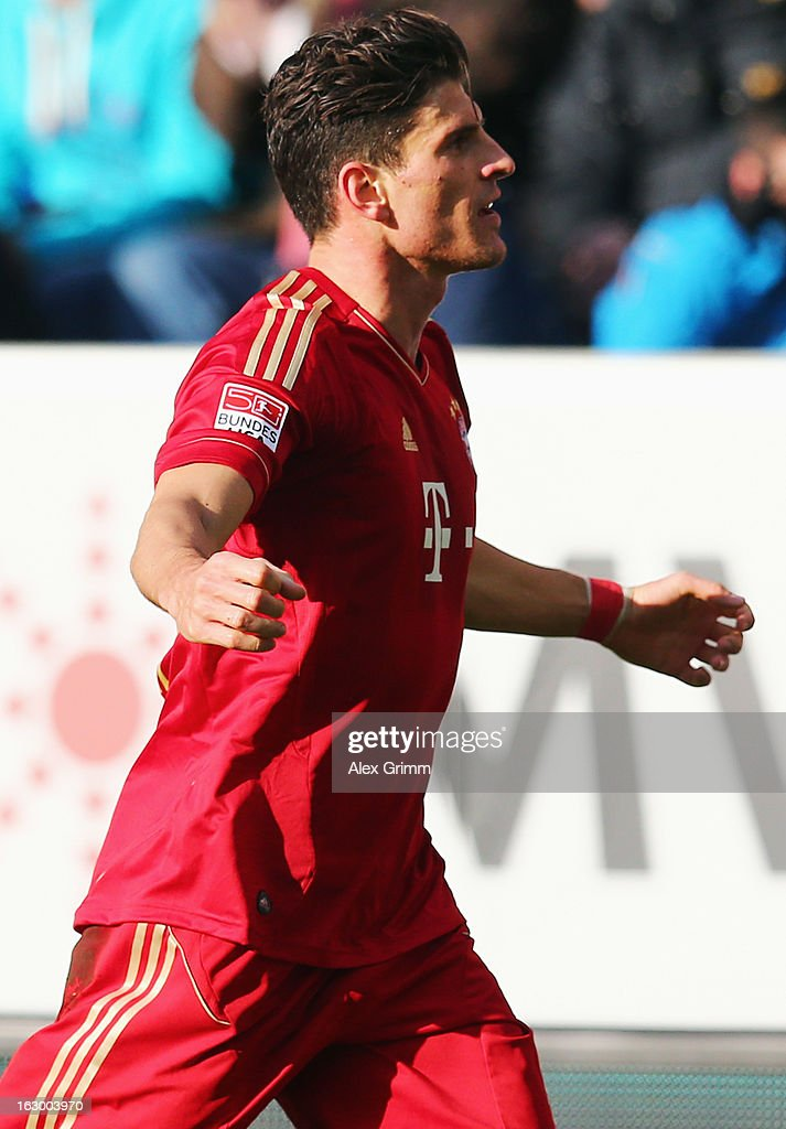<a gi-track='captionPersonalityLinkClicked' href=/galleries/search?phrase=Mario+Gomez+-+Soccer+Player&family=editorial&specificpeople=635161 ng-click='$event.stopPropagation()'>Mario Gomez</a> of Muenchen celebrates his team's first goal during the Bundesliga match between TSG 1899 Hoffenheim and FC Bayern Muenchen at Rhein-Neckar-Arena on March 3, 2013 in Sinsheim, Germany.