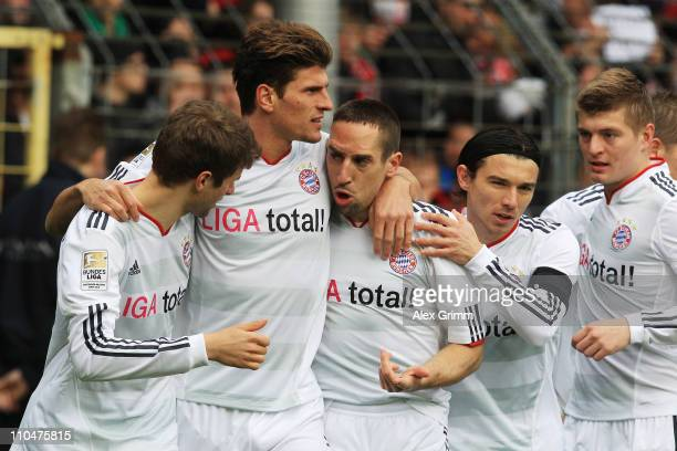 Mario Gomez of Muenchen celebrates his team's first goal with team mates Thomas Mueller Franck Ribery Danijel Pranjic and Toni Kroos during the...