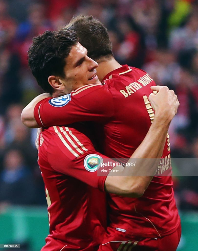 Mario Gomez (L) of Muenchen celebrates his team's fourth goal with team mate Xherdan Shaqiri during the DFB Cup Semi Final match between Bayern Muenchen and VfL Wolfsburg at Allianz Arena on April 16, 2013 in Munich, Germany.