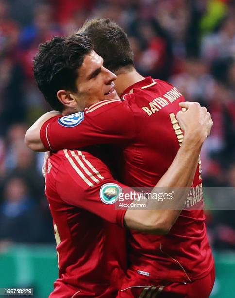 Mario Gomez of Muenchen celebrates his team's fourth goal with team mate Xherdan Shaqiri during the DFB Cup Semi Final match between Bayern Muenchen...