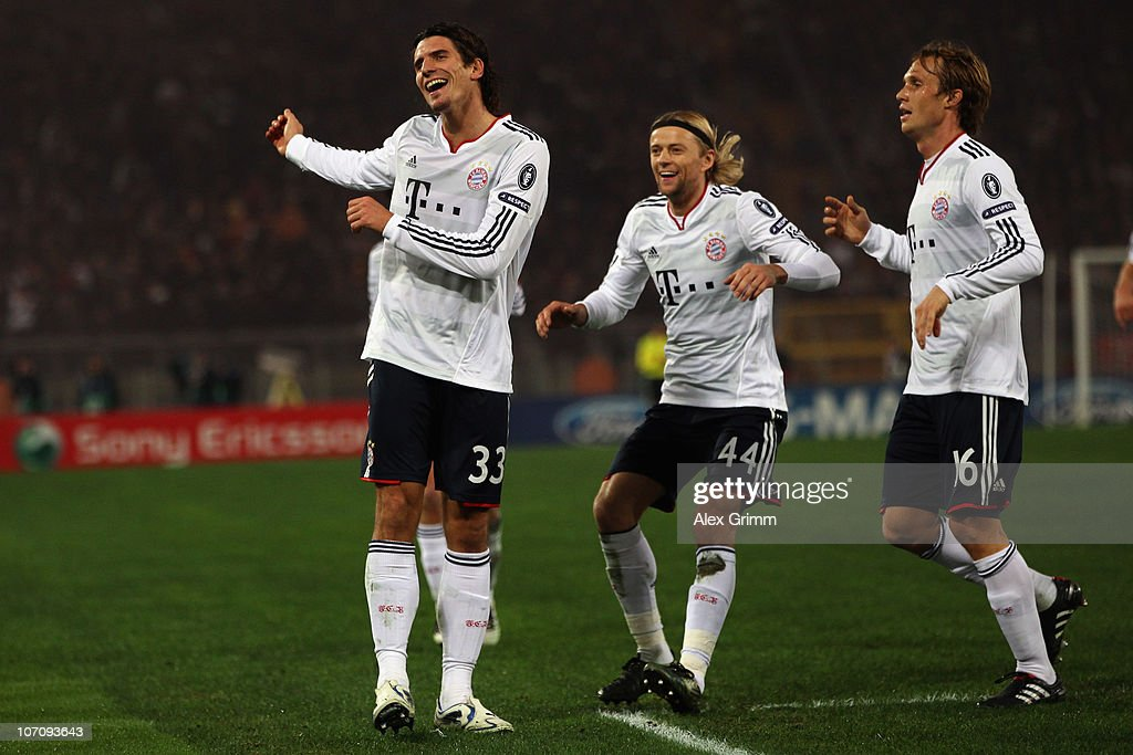 <a gi-track='captionPersonalityLinkClicked' href=/galleries/search?phrase=Mario+Gomez+-+Soccer+Player&family=editorial&specificpeople=635161 ng-click='$event.stopPropagation()'>Mario Gomez</a> of Muenchen celebrates his team's second goal with team mates Anatoliy Tymoshchuk and <a gi-track='captionPersonalityLinkClicked' href=/galleries/search?phrase=Andreas+Ottl&family=editorial&specificpeople=645670 ng-click='$event.stopPropagation()'>Andreas Ottl</a> (L-R) during the UEFA Champions League group E match between AS Roma and FC Bayern Muenchen at Stadio Olimpico on November 23, 2010 in Rome, Italy.