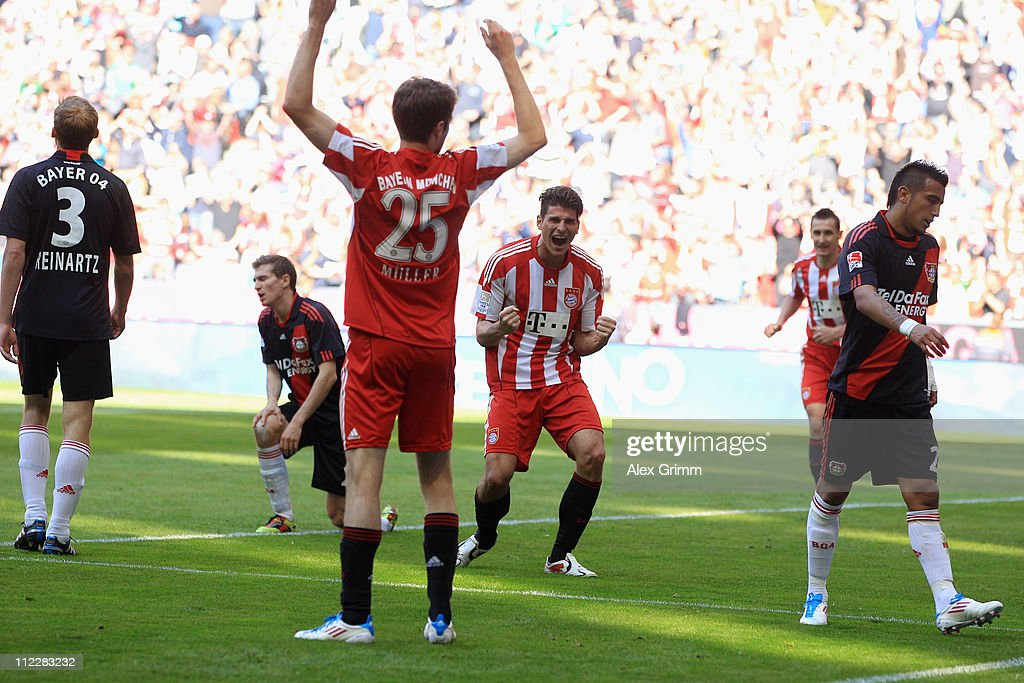 Mario Gomez (C) of Muenchen celebrates his team's second goal with team mates Thomas Mueller (front) as Stefan Reinartz, Daniel Schwaab and Arturo Vidal (L-R) of Leverkusen react during the Bundesliga match between FC Bayern Muenchen and Bayer Leverkusen at Allianz Arena on April 17, 2011 in Munich, Germany.