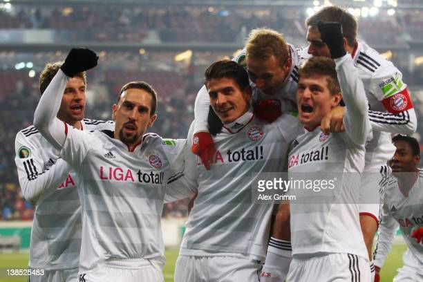 Mario Gomez of Muenchen celebrates his team's second goal with team mates during the DFB Cup Quarter Final match between VfB Stuttgart and Bayern...