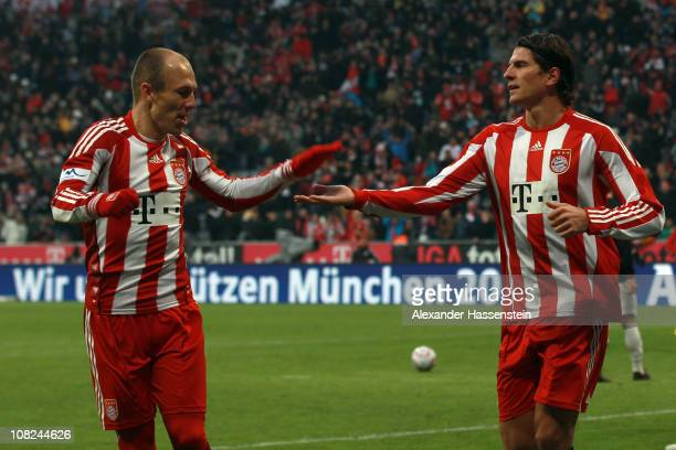 Mario Gomez of Muenchen celebrates scores the second team goal with his team mate Arjen Robben during the Bundesliga match between FC Bayern Muenchen...