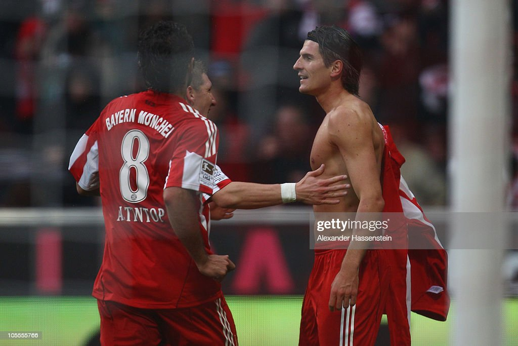 Mario Gomez (R) of Muenchen celebrates scoring his 2nd team goal with his team mates Bastian Schweinsteiger (C) and Hamit Altintop during the Bundesliga match between FC Bayern Muenchen and Hannover 96 at Allianz Arena on October 16, 2010 in Munich, Germany.