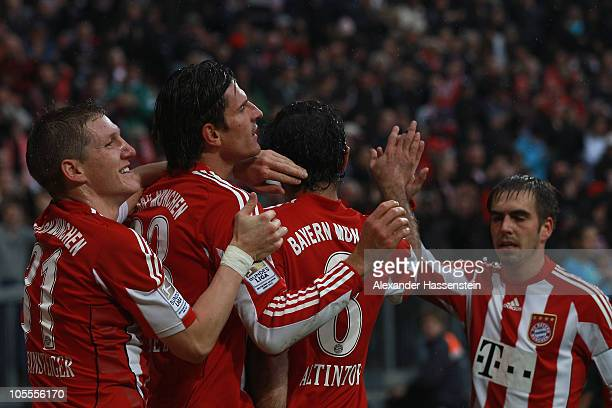 Mario Gomez of Muenchen celebrates scoring his 3rd team goal with his team mate Bastian Schweinsteiger Hamit Altintop and Philipp Lahm during the...