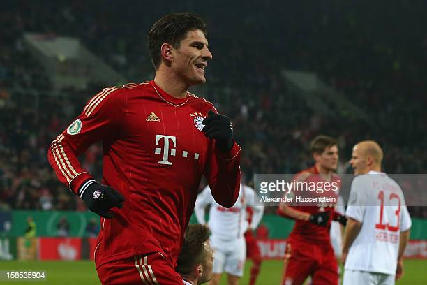 Mario Gomez of Muenchen celebrates scoring the opening goal during the DFB cup round of sixteen match between FC Augsburg and FC Bayern Muenchen at...