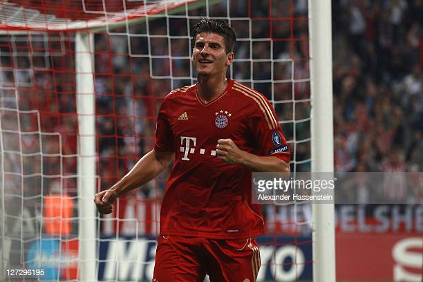 Mario Gomez of Muenchen celebrates scoring the second team goal during the UEFA Champions League group A match between FC Bayern Muenchen and...