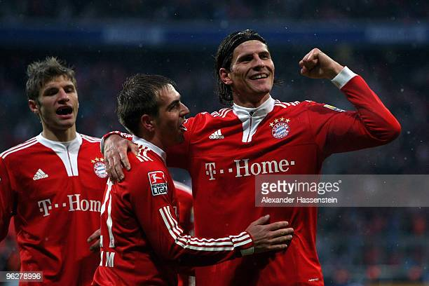 Mario Gomez of Muenchen celebrates scoring the second team goal with his team mates Philipp Lahm and Thomas Mueller during the Bundesliga match...