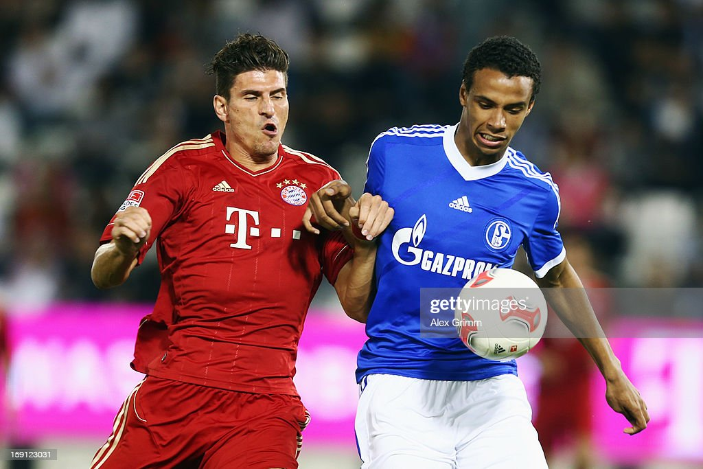 <a gi-track='captionPersonalityLinkClicked' href=/galleries/search?phrase=Mario+Gomez+-+Soccer+Player&family=editorial&specificpeople=635161 ng-click='$event.stopPropagation()'>Mario Gomez</a> (L) of Muenchen is challenged by <a gi-track='captionPersonalityLinkClicked' href=/galleries/search?phrase=Joel+Matip&family=editorial&specificpeople=4462851 ng-click='$event.stopPropagation()'>Joel Matip</a> of Schalke during the friendly match between Bayern Muenchen and FC Schalke 04 at Jassim Bin Hamad Stadium on January 8, 2013 in Doha, Qatar.