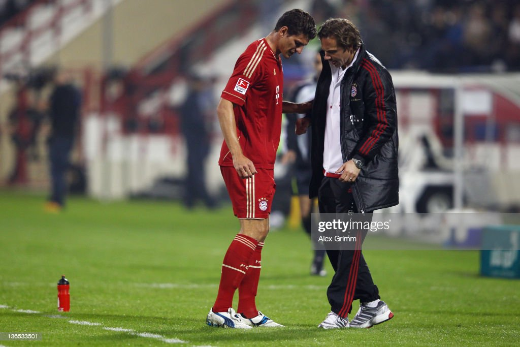 Mario Gomez of Muenchen leaves the pitch during the international friendly match between AlAhly Cairo and Bayern Muenchen at AlRayyan Stadium on...