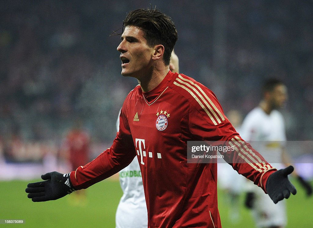<a gi-track='captionPersonalityLinkClicked' href=/galleries/search?phrase=Mario+Gomez+-+Soccer+Player&family=editorial&specificpeople=635161 ng-click='$event.stopPropagation()'>Mario Gomez</a> of Muenchen reacts during the Bundesliga match between FC Bayern Muenchen and VfL Borussia Moenchengladbach at Allianz Arena on December 14, 2012 in Munich, Germany.