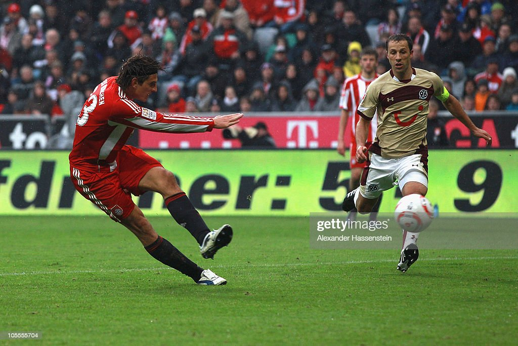 Mario Gomez of Muenchen scores his 2nd team goal whilst Steven Cherundolo of Hannover looks on during the Bundesliga match between FC Bayern Muenchen...