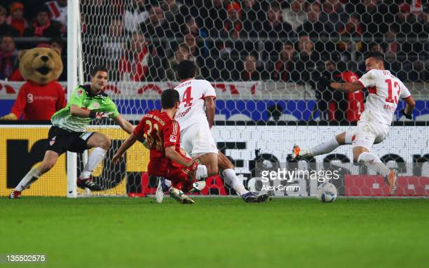 Mario Gomez of Muenchen scores his team's second goal against Sven Ulreich Maza and Timo Gebhart of Stuttgart during the Bundesliga match between VfB...