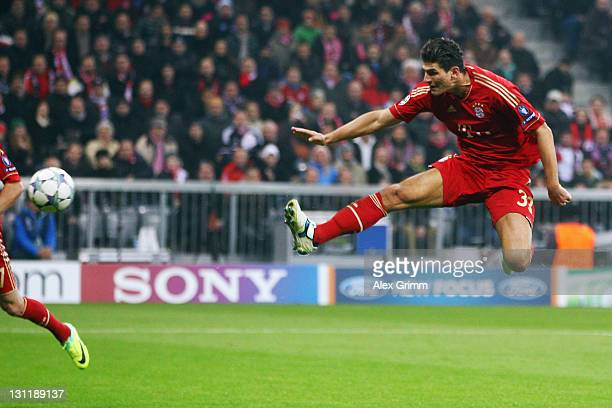 Mario Gomez of Muenchen scores his team's second goal during the UEFA Champions League group A match between FC Bayern Muenchen and SSC Napoli at...