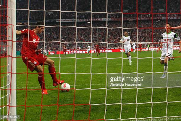 Mario Gomez of Muenchen scores the 4th team goal during the DFB Cup Semi Final match between Bayern Muenchen and VfL Wolfsburg at Allianz Arena on...