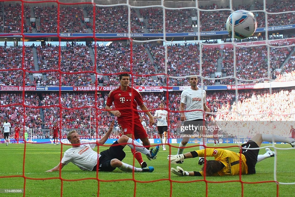 Mario Gomez (C) of Muenchen scores the 4th team goal during the Bundesliga match between FC Bayern Muenchen and SC Freiburg at Allianz Arena on September 10, 2011 in Munich, Germany.