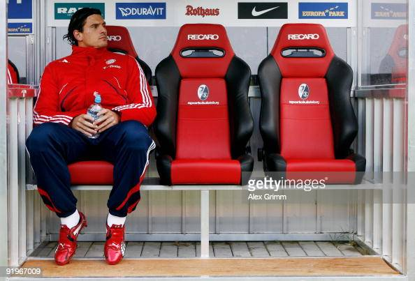 Mario Gomez of Muenchen sits on the substitutes bench before the Bundesliga match between SC Freiburg and Bayern Muenchen at the Badenova Stadium on...