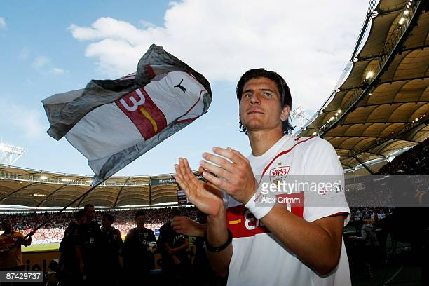 Mario Gomez of Stuttgart celebrates with supporters after the Bundesliga match between VfB Stuttgart and Energie Cottbus at the MercedesBenz Arena on...