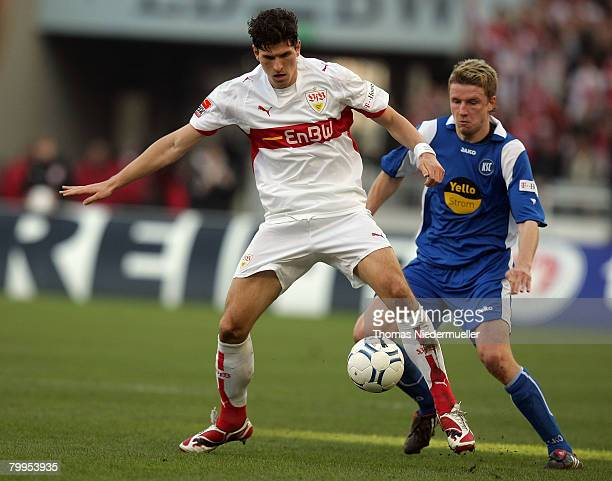 Mario Gomez of Stuttgart in action with Mike Franz of Karlsruhe during the Bundesliga match between VfB Stuttgart and SC Karlsruhe at the Gottlieb...