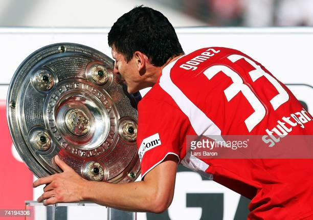 Mario Gomez of Stuttgart kisses the trophy after winning the German championship after the Bundesliga match between VFB Stuttgart and Energie Cottbus...