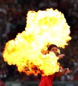 Mario Gomez of VfB Stuttgart walks through fireworks prior a preseason friendly match against Arsenal London on July 30 2008 in Stuttgart Germany