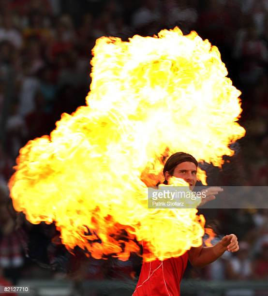 Mario Gomez of VfB Stuttgart walks through fireworks prior a preseason friendly match against Arsenal London on July 30 2008 in Stuttgart Germany
