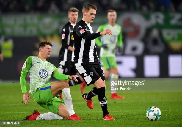 Mario Gomez of Wolfsburg and matthias Ginter of Moenchengladbach battle for the ball during the Bundesliga match between VfL Wolfsburg and Borussia...