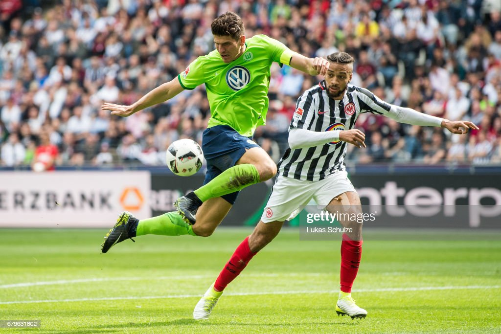 Mario Gomez (L) of Wolfsburg and Michael Hector (R) of Frankfurt fight for the ball during the Bundesliga match between Eintracht Frankfurt and VfL Wolfsburg at Commerzbank-Arena on May 6, 2017 in Frankfurt am Main, Germany.