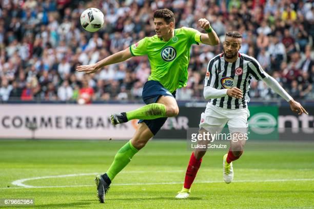 Mario Gomez of Wolfsburg and Michael Hector of Frankfurt fight for the ball during the Bundesliga match between Eintracht Frankfurt and VfL Wolfsburg...