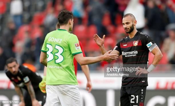 LEVERKUSEN GERMANY APRIL 2 Mario Gomez of Wolfsburg and Omer Toprak shake hands after the 33 at the Bundesliga soccer match between Bayer Leverkusen...
