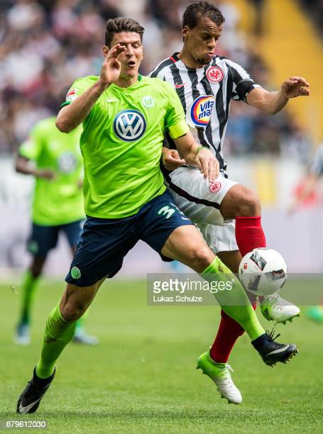 Mario Gomez of Wolfsburg and Timothy Chandler of Frankfurt fight for the ball during the Bundesliga match between Eintracht Frankfurt and VfL...