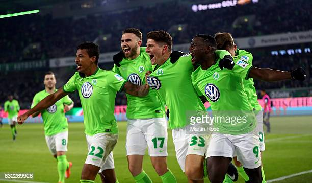 Mario Gomez of Wolfsburg celebrate with his team mates after scoring the opening goal during the Bundesliga match between VfL Wolfsburg and Hamburger...
