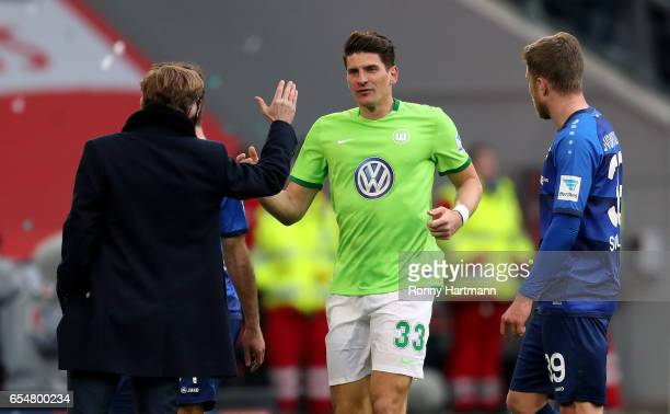 Mario Gomez of Wolfsburg celebrates after scoring his team's opening goal with head coach Andries Jonker of Wolfsburg during the Bundesliga match...