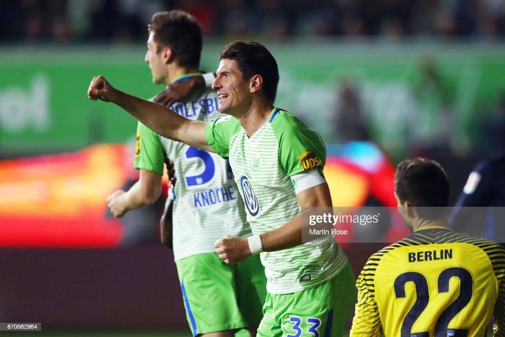 Mario Gomez of Wolfsburg celebrates his team's second goal during the Bundesliga match between VfL Wolfsburg and Hertha BSC at Volkswagen Arena on November 5, 2017 in Wolfsburg, Germany.