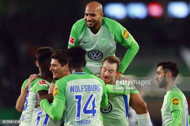Mario Gomez of Wolfsburg celebrates his team's second goal with team mates during the Bundesliga match between VfL Wolfsburg and Hertha BSC at...