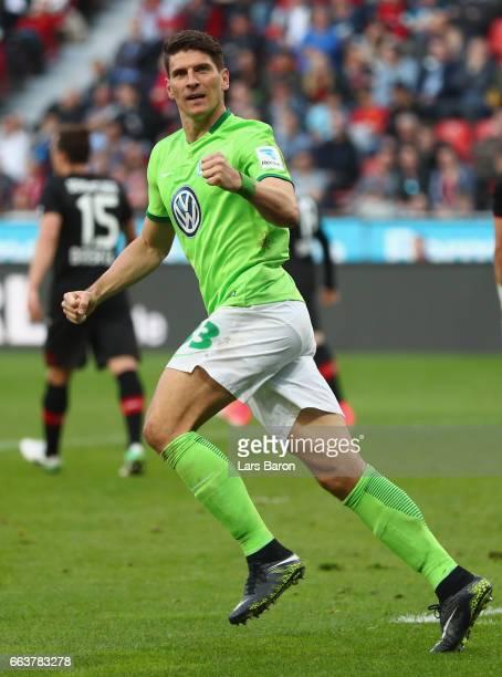 Mario Gomez of Wolfsburg celebrates scoring his first goal during the Bundesliga match between Bayer 04 Leverkusen and VfL Wolfsburg at BayArena on...