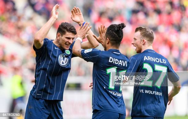 Mario Gomez of Wolfsburg celebrates the first goal for his team with Daniel Didavi of Wolfsburg and Maximilian Arnold of Wolfsburg during the...