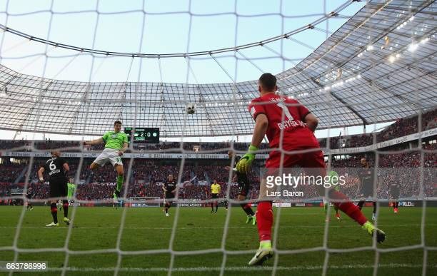 Mario Gomez of Wolfsburg heads his goal during the Bundesliga match between Bayer 04 Leverkusen and VfL Wolfsburg at BayArena on April 2 2017 in...
